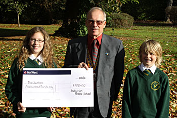 Dulverton School presents a cheque for Shelterbox